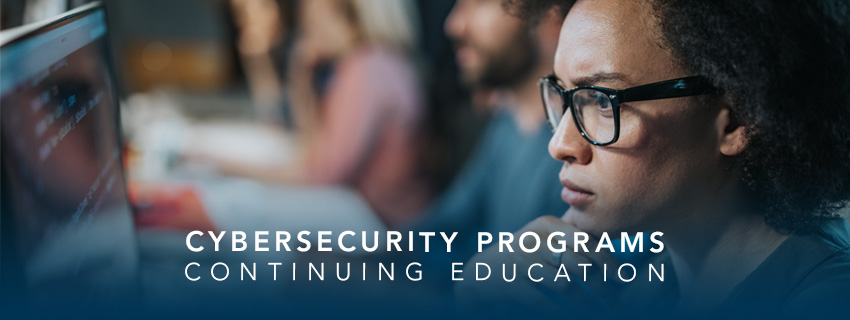 A woman looking at a computer screen and the words 'Cybersecurity programs - Continuing Education'